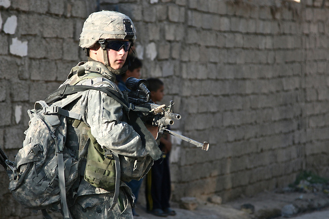 A soldier with Company C, 1st Battalion, 23rd Infantry Regiment patrols the streets of Baqubah, Iraq on the third day of a U.S.-led offensive to push insurgents from the city. June 21, 2007. DREW BROWN/STARS AND STRIPES