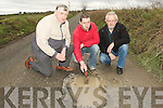 ROAD DAMAGE: Checking out some of the dangerous pot holes in Leitrim East, Moyvane on Thursday last were concerned locals Michael Windle, Sean Windle and Richard Garry.