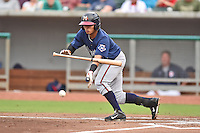 Mississippi Braves shortstop Gustavo Nunez #4 squares to bunt during a game against the Tennessee Smokies at Smokies Park on July 21, 2014 in Kodak, Tennessee. The Braves defeated the Smokies 4-3. (Tony Farlow/Four Seam Images)