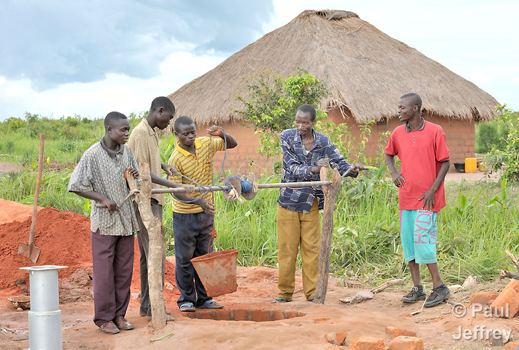 A group of neighbors in the Congo dig a well together with assistance from the United Methodist Committee on Relief.
