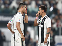 Calcio, Serie A: Juventus - Genoa, Turin, Allianz Stadium, October 20, 2018.<br /> Juventus' Cristiano Ronaldo (l) speaks with his teammate Paulo Dybala (r) during the Italian Serie A football match between Juventus and Genoa at Torino's Allianz stadium, October 20, 2018.<br /> UPDATE IMAGES PRESS/Isabella Bonotto