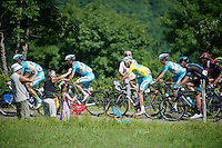 Vincenzo Nibali (ITA/Astana) is well escorted by his teammates up the Côte de Rogna (7.6km/4.9%)<br /> <br /> 2014 Tour de France<br /> stage 11: Besançon - Oyonnax (187km)