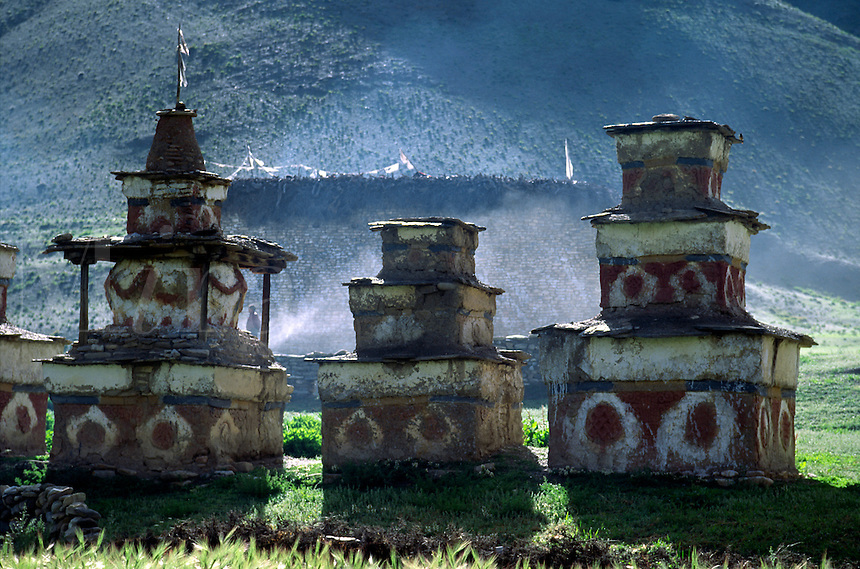 Tibetan Buddhist CHORTENS sit in a line across the DO TARAP VALLEY - DOLPO DISTRICT, NEPAL