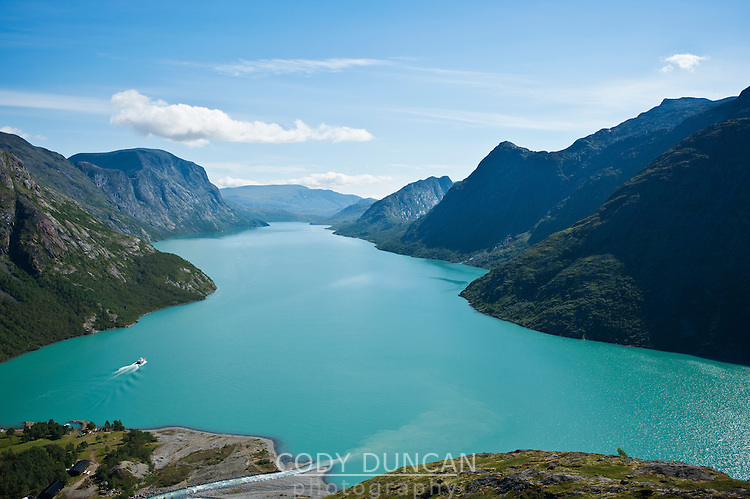 Colorful water of Lake Gjende from above Memurubu looking towards Gjendesheim, Jotunheimen national park, Norway