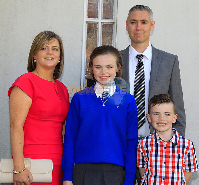 Yvonne and John McQuail with Caitlin and Jake during Confirmation at St. Joseph's Church in Mell, Drogheda on Monday 11th May 2015.<br /> Picture:  Thos Caffrey / www.newsfile.ie