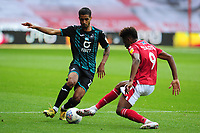 Kyle Naughton of Swansea City vies for possession with Nuno da Costa of Nottingham Forest during the Sky Bet Championship match between Nottingham Forest and Swansea City at the City Ground Stadium in Nottingham, England, UK. Wednesday 15 July 2020