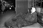Teenage girls sleeping rough in a shop doorway The Strand central London, people walk past. 1990s. UK