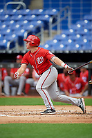 Washington Nationals Jakson Reetz (14) follows through on a swing during a Florida Instructional League game against the Miami Marlins on September 26, 2018 at the Marlins Park in Miami, Florida.  (Mike Janes/Four Seam Images)