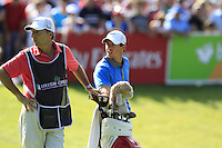 Rory McIlroy (NIR) and caddy J.P.Fitzgerald at the 18th green during Friday's Round 2 of the 2014 Irish Open held at Fota Island Resort, Cork, Ireland. 20th June 2014.<br /> Picture: Eoin Clarke www.golffile.ie