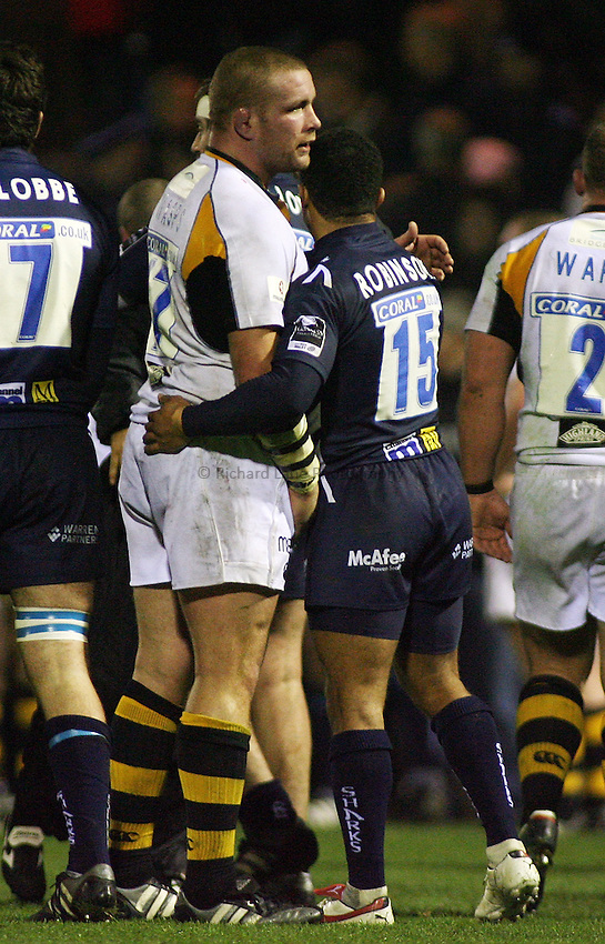Photo: Paul Thomas..Sale Sharks v London Wasps. Guinness Premiership. 03/11/2006...Old England team mates Wasps' Phil Vickery (L) and Sale's  Jason Robinson congratulate each other after the game.
