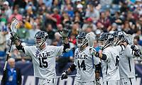 Foxborough, Massachusetts - May 28, 2018: NCAA Division I tournament final. Yale University (white) defeated Duke University (blue/white), 13-11, at Gillette Stadium.<br /> Goal celebration.