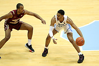 CHAPEL HILL, NC - FEBRUARY 1: Garrison Brooks #15 of the University of North Carolina is guarded by Steffon Mitchell #41 of Boston College during a game between Boston College and North Carolina at Dean E. Smith Center on February 1, 2020 in Chapel Hill, North Carolina.