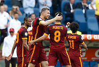 Calcio, Serie A: Lazio vs Roma. Roma, stadio Olimpico, 3 aprile 2016.<br /> Roma's Edin Dzeko, second from left, celebrates with teammates after scoring during the Italian Serie A football match between Lazio and Roma at Rome's Olympic stadium, 3 April 2016.<br /> UPDATE IMAGES PRESS/Riccardo De Luca