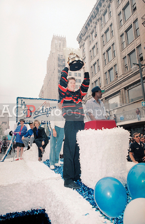 Oct. 28, 1988 - Los Angeles, California - USA - Los Angeles Dodgers Pitcher Orel Hersheiser hoists the World Series trophy during a World Series Victory Parade in downtown Los Angeles on Oct. 28, 1988. The Dodgers beat the Oakland Athletics in the 1988 World Series. In 1988<br /> Hershiser put together one of the best single seasons in pitching history in 1988. That year, he led the league in wins (23), innings (267), and complete games (15). He finished the season with a record 59 consecutive scoreless innings pitched, breaking the mark held by Dodger great Don Drysdale. He also won his first Gold Glove. He was unanimously selected as the Cy Young Award winner, with a record of 23-8 and a 2.26 ERA.