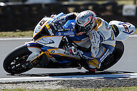 Marco Melandri (ITA) riding the BMW S1000 RR HP4 (33) of the BMW Motorrad GoldBet SBK Team rounds turn 11 during a practise session on day two of round one of the 2013 FIM World Superbike Championship at Phillip Island, Australia.