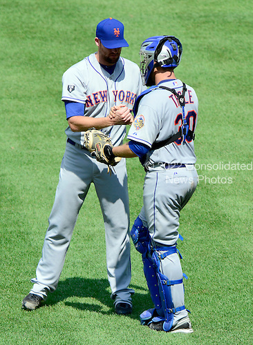 New York Mets pitcher Bobby Parnell (39), left and catcher Josh Thole (30) congratulate each other after a 9 - 5 win over the Washington Nationals, breaking a six game losing streak, at Nationals Park in Washington, D.C. on Thursday, July 19, 2012. .Credit: Ron Sachs / CNP.(RESTRICTION: NO New York or New Jersey Newspapers or newspapers within a 75 mile radius of New York City)