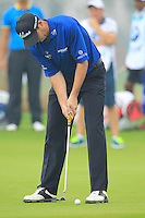 David Howell (ENG) putts on the 14th green during Friday's Round 2 of the 2014 BMW Masters held at Lake Malaren, Shanghai, China 31st October 2014.<br /> Picture: Eoin Clarke www.golffile.ie