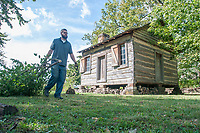 NWA Democrat-Gazette/J.T. WAMPLER Aaron Loehndorf helps remove a mulberry tree Monday Oct. 8, 2018 at the Shiloh Museum of Ozark History in Springdale. The tree is being removed to make room for more native species of plants and trees. Loehndorf is a collections and education specialist at the museum. For more information about the museum visit www.shilohmuseum.org/