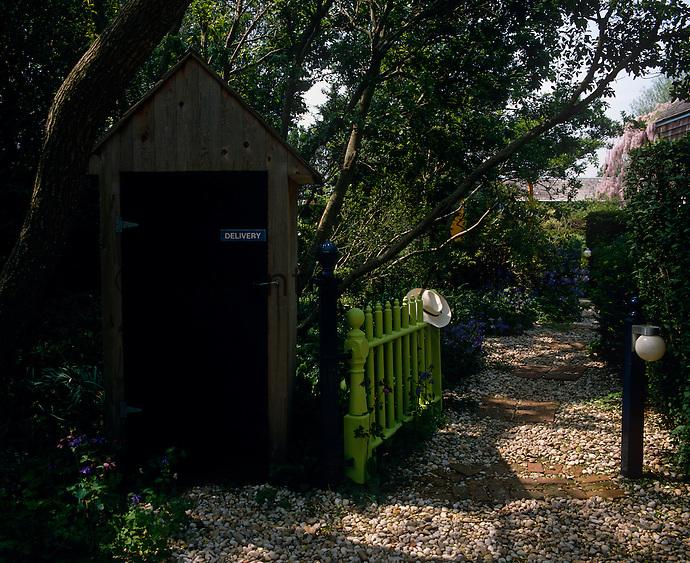An inviting entryway into artist Robert Dash's garden