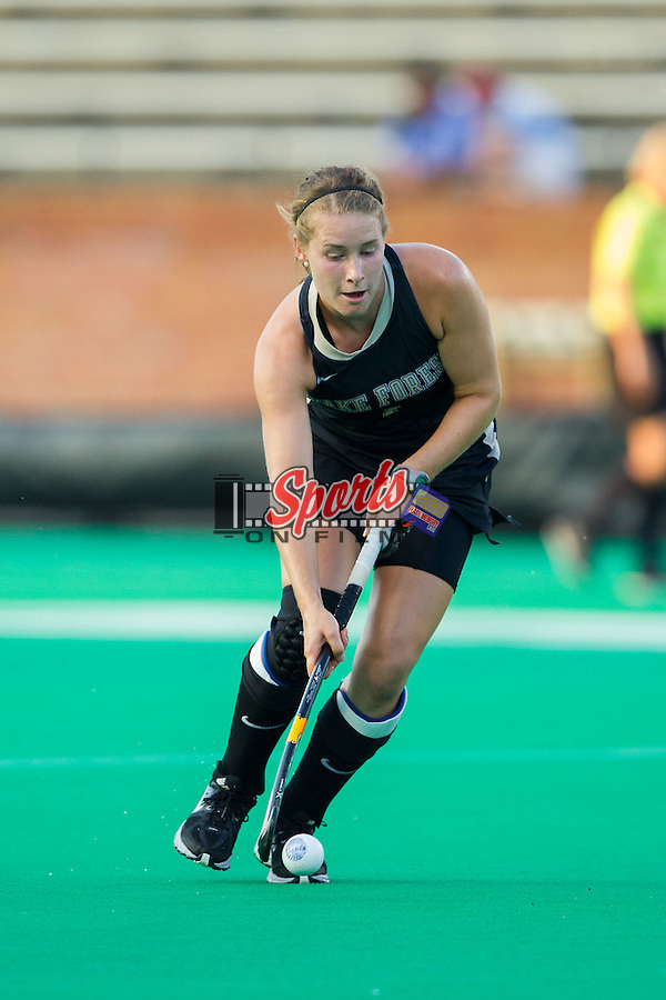 Christine Conroe (4) of the Wake Forest Demon Deacons pushes the ball up the field during first half action against the Northwestern Wildcats at Kentner Stadium on September 11, 2014 in Winston-Salem, North Carolina.  The Demon Deacons defeated the Wildcats 1-0.  (Brian Westerholt / Sports On Film)