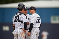 GCL Yankees East pitching coach Justin Pope (22) talks with pitcher Luis Ojeda (47) and catcher Miguel Torres (31) during a Gulf Coast League game against the GCL Phillies East on July 31, 2019 at Yankees Minor League Complex in Tampa, Florida.  GCL Phillies East defeated the GCL Yankees East 4-3 in the second game of a doubleheader.  (Mike Janes/Four Seam Images)