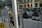 Tourists at the site of Checkpoint Charlie. The Wall was opened 15 years ago on 9th November 1989.