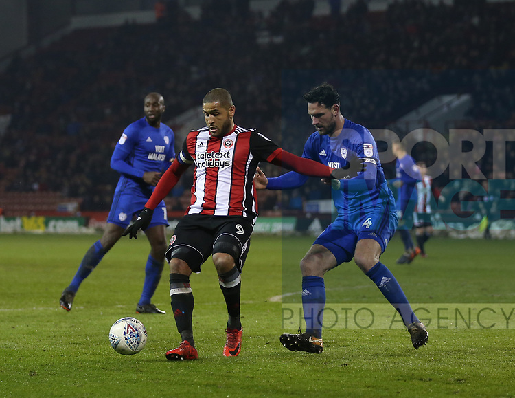 Leon Clarke of Sheffield Utd and Sean Morrison of Cardiff City during the Championship match at Bramall Lane Stadium, Sheffield. Picture date 02nd April, 2018. Picture credit should read: Simon Bellis/Sportimage