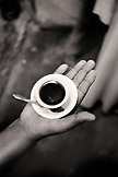 ERITREA, Massawa, a hand holding a small cup of coffee (B&W)