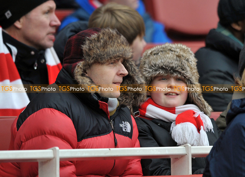 Fans don't feel the cold when their team wins 7-1 - Arsenal vs Blackburn Rovers - Barclays Premier League Football at the Emirates Stadium, London - 04/02/2012 - MANDATORY CREDIT: Martin Dalton/TGSPHOTO - Self billing applies where appropriate - 0845 094 6026 - contact@tgsphoto.co.uk - NO UNPAID USE.