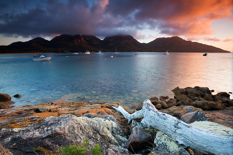 Sunset view of Coles Bay, with The Hazards range beyond.  Freycinet National Park, Tasmania, Australia