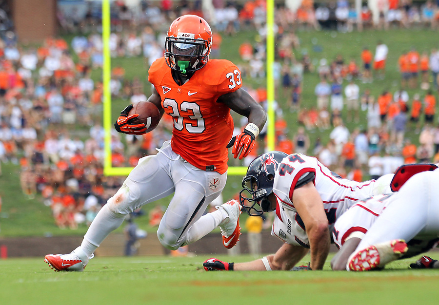 Virginia Cavaliers running back Perry Jones (33) runs past Richmond Spiders linebacker Cole Gonet (44) for a touchdown during the second half of an NCAA football game Saturday September, 1, 2012 at Scott Stadium in Charlottesville, Va. Virginia defeated Richmond 43-19.