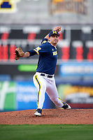 Michigan Wolverines relief pitcher William Tribucher (22) delivers a pitch during the second game of a doubleheader against the Canisius College Golden Griffins on February 20, 2016 at Tradition Field in St. Lucie, Florida.  Michigan defeated Canisius 3-0.  (Mike Janes/Four Seam Images)