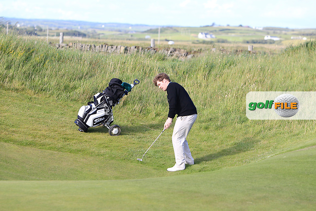 Mark Timmins (Coolattin) on the 16th green during Round 1 of the South of Ireland Amateur Open Championship at LaHinch Golf Club on Wednesday 22nd July 2015.<br /> Picture:  Golffile   Thos Caffrey