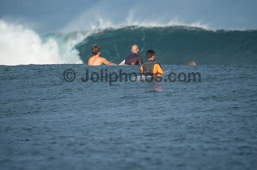 Namotu Island Resort, Namotu, Fiji. (Wednesday June 4, 2014) Aritz Aranburu (EUK), Fred Patacchia (HAW) and Gabriel Medina (BRA) watch as a set rolls into Cloudbreak.  – Free surfing session went down this morning while organises debated a starting time for the Fiji Pro. Photo: joliphotos.com
