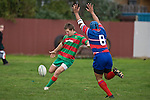 Steven Kennedy clear from inside his 22 as Gary Saifoloi attempts to charge the kick down. Counties Manukau Premier rugby game between Waiuku & Ardmore Marist played at Waiuku on Saturday May 10th 2008..Ardmore Marist won 27 - 6 after leading 10 - 6 at halftime.