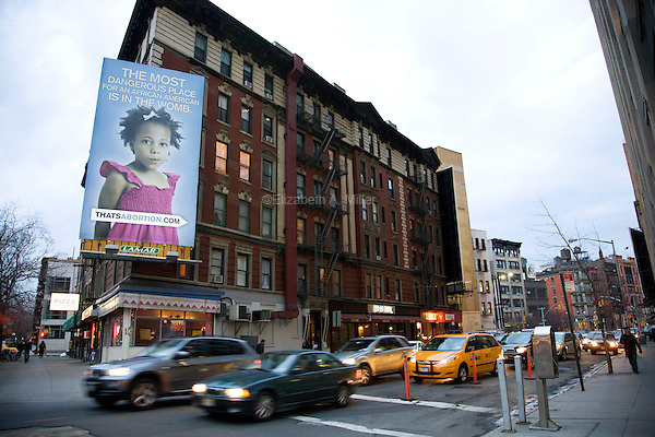 """As part of a national campaign, the anti-abortion group Life Always unveiled a controversial billboard on 22 February 2011 in New York City, New York, on the corner of Watts Street and Sixth Avenue.  About a half-mile from the Planned Parenthood on Bleeker Street, the billboard shows an image of an African American girl and the caption, """"The most dangerous place for an African American is in the womb.""""  Image taken on  24 February 2011."""