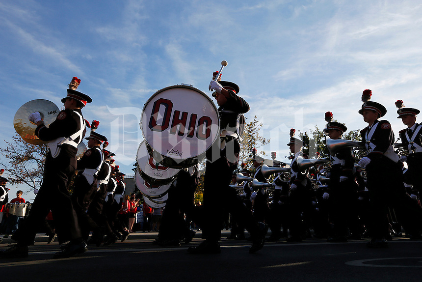 The Ohio State Marching Band marches to the Skull Session at St. Johns Arena before the NCAA football game between the Ohio State Buckeyes and the Wisconsin Badgers at Ohio Stadium in Columbus, Saturday evening, September 28, 2013. (Columbus Dispatch  / Eamon Queeney)