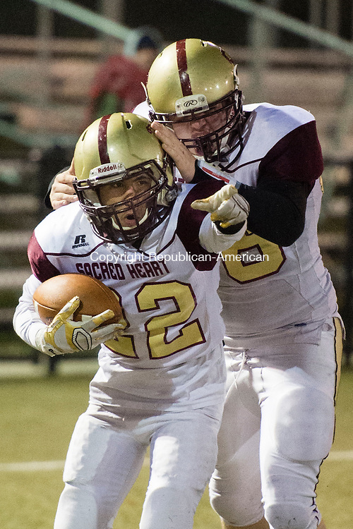 WATERBURY, CT - 25 November 2015-112515EC04--  Sacred Heart's Joel Guzman scores a touchdown against Wilby Friday night and celebrates with David Lavigne. Erin Covey Republican-American.