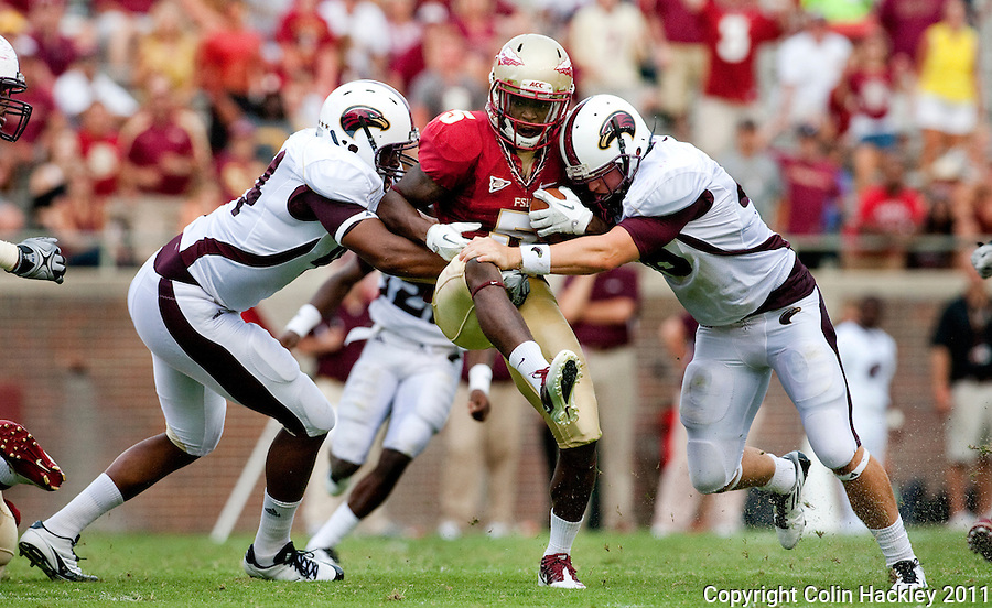 TALLAHASSEE, FL 9/3/11-FSU-ULM FB090311 CH-Florida State's Greg Reid is sandwiched by the University of Louisiana at Monroe's Jordan Landry, left, and Hunter Kissinger during second half action Saturday at Doak Campbell Stadium in Tallahassee. The Seminole's beat the Warhawks 34-0. .COLIN HACKLEY PHOTO