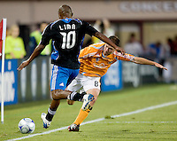 13 September 2008: Richard Mulrooney of the Dynamo fights for the ball against Francisco Lima of the Earthquakes near out-of-bound line during the game at Buck Shaw Stadium in Santa Clara, California.   San Jose Earthquakes tied Houston Dynamo, 1-1.
