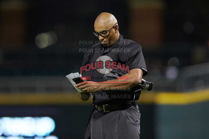 Home plate umpire Jose Navas updates his lineup card during the International League game between the Scranton/Wilkes-Barre RailRiders and the Charlotte Knights at BB&T BallPark on August 14, 2019 in Charlotte, North Carolina. The Knights defeated the RailRiders 13-12 in ten innings. (Brian Westerholt/Four Seam Images)