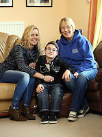 Pictured L-R: Volunteer Allison Morgan with 10 year old James Morris and his mother Diane Morris who is also a volunteer. Monday 17 March 2014<br /> Re: Swansea City FC Ambassador, Lee Trundle has visited The Play and Leisure Opportunities Library (PLOL) to see how Comic Relief money is making a difference to vulnerable people in Swansea. The PLOL provides play sessions for children and adults with profound disabilities. A small Comic Relief grant has allowed the group to purchase and cover the insurance cost of sensory toys which they loan to families