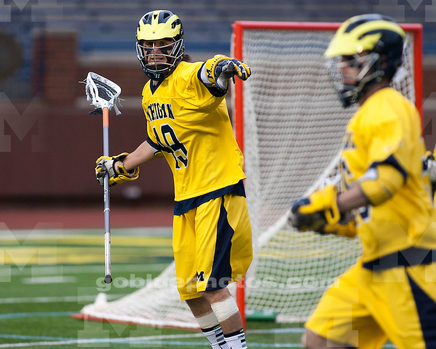 "The University of Michigan men's lacrosse team lost to No. 13 Ohio State, 18-7, in the ""Battle at the Big House"" at Michigan Stadium in Ann Arbor, Mich., on April 13, 2013."