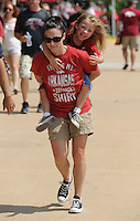 NWA Democrat-Gazette/ANDY SHUPE<br /> Elisha Moeller of Villonia carries her 4-year-old daughter, Madison, on her back Saturday, Sept. 5, 2015, as they walk to Razorback Stadium in Fayetteville before the University of Arkansas' football game with the University of Texas at El Paso. Visit nwadg.com/photos to see more from the game.