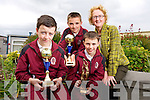 Winners of the Kerry Primary Schools County Football Skills Final, Padraig White, Conor Hayes (Overall Individual Winner) and Padraig McCannon from Mercy Moyderwell Primary, here with principal Moira Quinlan
