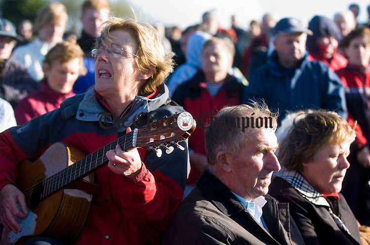 Carmel O Brien on guitar and singing with the choir during the annual Kilmaley Meitheal sponsored Walk Mass and blessing of the new graveyard. Photograph by John Kelly.