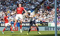 Bolton Wanderers' Aaron Wilbraham heads at goal under pressure from Nottingham Forest's Jack Hobbs<br /> <br /> Photographer Andrew Kearns/CameraSport<br /> <br /> The EFL Sky Bet Championship - Bolton Wanderers v Nottingham Forest - Sunday 6th May 2018 - Macron Stadium - Bolton<br /> <br /> World Copyright &copy; 2018 CameraSport. All rights reserved. 43 Linden Ave. Countesthorpe. Leicester. England. LE8 5PG - Tel: +44 (0) 116 277 4147 - admin@camerasport.com - www.camerasport.com