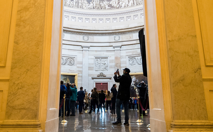 UNITED STATES - MARCH 12: A tourist takes a photo with his phone in the Routnda while on a Capitol tour on Monday, March 12, 2018. (Photo By Bill Clark/CQ Roll Call)