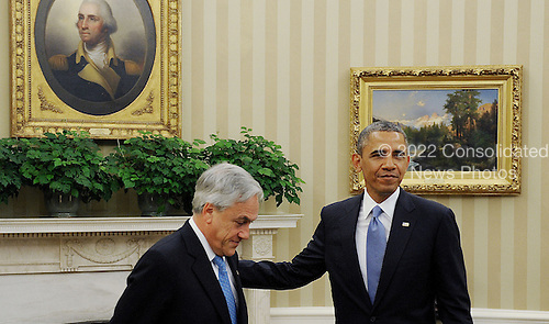 United States President Barack Obama meets with President Sebasti&aacute;n Pi&ntilde;era of Chile in the Oval Office of the White House June 4 , 2013 in Washington, DC. <br /> Credit: Olivier Douliery / Pool via CNP