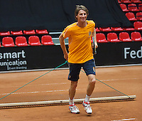 The Netherlands, Den Bosch, 16.04.2014. Fed Cup Netherlands-Japan, training, captain Paul Haarhuis (NED) is sweeping the clay court <br /> Photo:Tennisimages/Henk Koster